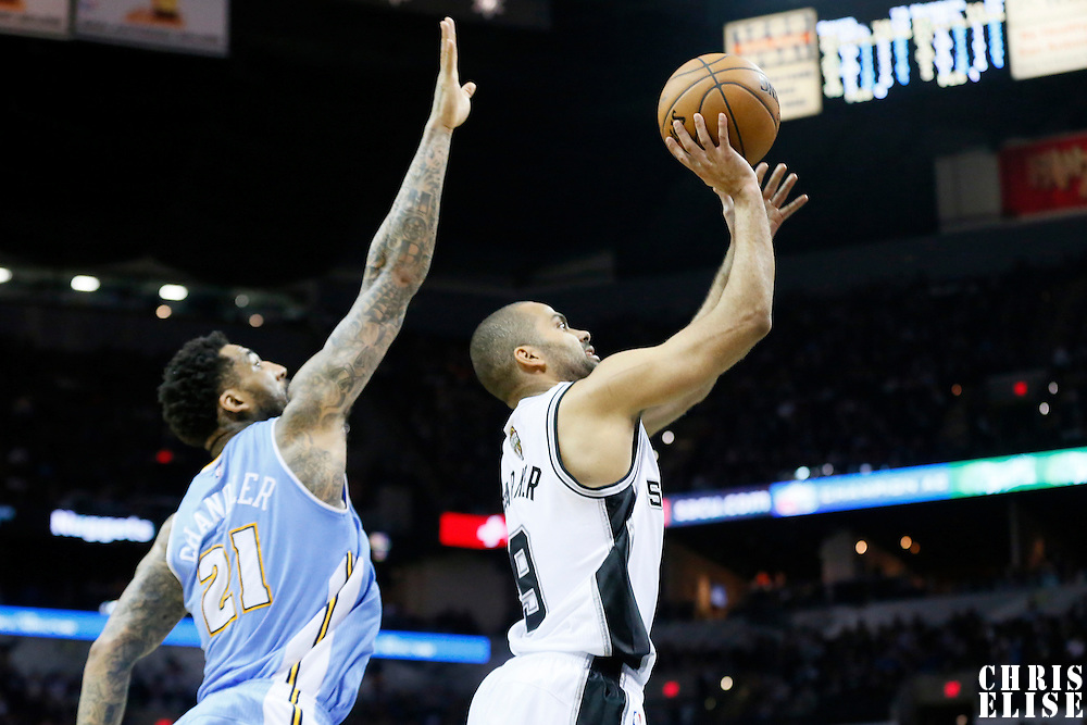 03 April 2015: San Antonio Spurs guard Tony Parker (9) takes a jump shot over Denver Nuggets forward Wilson Chandler (21) during the San Antonio Spurs 123-93 victory over the Denver Nuggets , at the AT&T Center, San Antonio, Texas, USA.