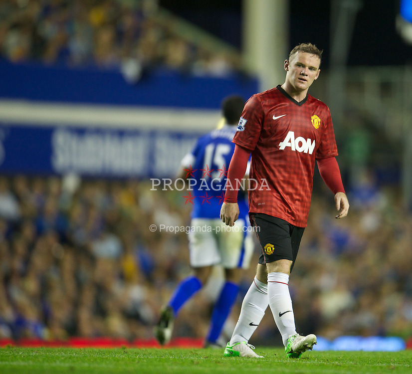 LIVERPOOL, ENGLAND - Monday, August 20, 2012: Manchester United's Wayne Rooney looks dejected as his side lose 1-0 to Everton during the Premiership match at Goodison Park. (Pic by David Rawcliffe/Propaganda)