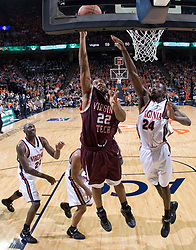 Virginia Cavaliers guard/forward Mamadi Diane (24) defends a Virginia Tech Hokies guard Jamon Gordon (22) shot.  The Virginia Cavaliers Men's Basketball Team defeated the Virginia Tech Hokies 69-56 at the John Paul Jones Arena in Charlottesville, VA on March 1, 2007.