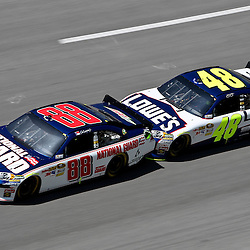 April 17, 2011; Talladega, AL, USA; NASCAR Sprint Cup Series driver Jimmie Johnson (48) drafts Dale Earnhardt Jr. (88) during the Aarons 499 at Talladega Superspeedway.   Mandatory Credit: Derick E. Hingle