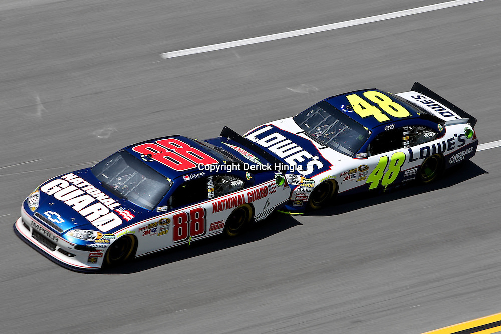 April 17, 2011; Talladega, AL, USA; NASCAR Sprint Cup Series driver Jimmie Johnson (48) drafts Dale Earnhardt Jr. (88) during the Aarons 499 at Talladega Superspeedway.   Mandatory Credit: Derick E. Hingle