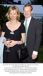 The EARL & COUNTESS OF DERBY at a dinner in London on 20th May 2002.			PAF 25