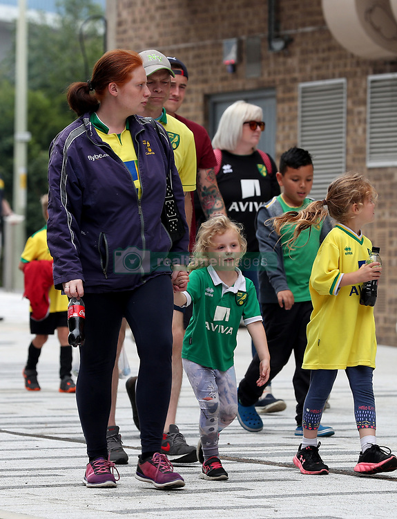 Fans make their way into Carrow Road before kick off in the pre-season match at Carrow Road, Norwich.