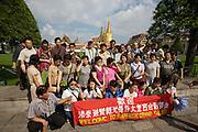 Wat Phra Keo and Grand Palace. Tourist groups posing for souvenir photos.