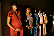Surrogates pose for a photograph in the surrogates hostel on the 3rd floor of Dr. Nayana Patel's Akanksha IVF and surrogacy center in Anand, Gujarat, India on 10th December 2012. Photo by Suzanne Lee / Marie-Claire France