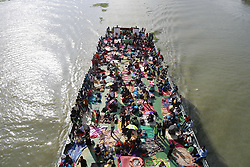 June 24, 2017 - Dhaka, Bangladesh - Bangladeshi Muslim people travel home to celebrate Eid al-Fitr in an overcrowded ferry in Dhaka, Bangladesh, June 24, 2017. (Credit Image: © Suvra Kanti Das via ZUMA Wire)