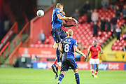 Nottingham Forest defender Michael Dawson (20) wins a header over Charlton Athletic midfielder Chuks Aneke (10) during the EFL Sky Bet Championship match between Charlton Athletic and Nottingham Forest at The Valley, London, England on 21 August 2019.