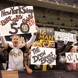 2009 October 18: New Orleans Saints fans celebrate in the stands following a 48-27 win by the New Orleans Saints over the New York Giants at the Louisiana Superdome in New Orleans, Louisiana.