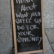 Humorous blackboard sign outside reflecting the sense of humor and attitude of the coffee shop.<br />