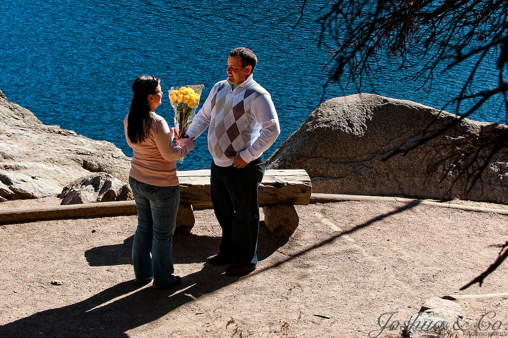 Jason asks Stormi for her hand in marriage during a surprise proposal on the shore of Bear Lake in Rocky Mountain National Park near Estes Park, Colorado, on Wednesday, Oct. 19, 2011...Photo by Joshua Buck /  / Joshua & Co. Photography..www.joshuacophotography.com