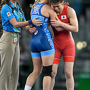 Helen Maroulis, in blue, consoled her opponent, three-time Olympic champion Saori Yoshida of Japan, after Maroulis defeated Yoshida to earn the United States its first Olympic gold in women's wrestling in dramatic fashion Thursday evening at Carioca Arena 2 during the 2016 Summer Olympics Games in Rio de Janeiro, Brazil.