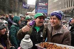 February 3, 2018 - Minneapolis, MN, USA - Minneapolis mayor Jacob Frey bonds with Philadelphia Eagles fan Dave Shroyer as he hands out sambusa, a fried Somali dish with a savory filling from the restaurant Afro Deli, to Eagles fans during their rally on Saturday, Feb. 3, 2018, as part of Super Bowl Live in downtown Minneapolis. (Credit Image: © Anthony Souffle/TNS via ZUMA Wire)
