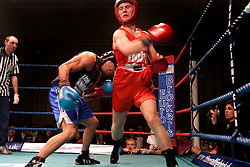 UK ENGLAND LONDON 2DEC04 - Boxer Justin Freedman (Blue) attacks his opponent James Twigg (Red) during their fight at the 4th Real Fight Club City Broker Christmas Bash at the London Mariott Hotel, Mayfair. The high-adrenaline contact sport of White Collar Boxing originated in New York 17 years ago and attracts mostly young males from the financial, legal and medical professions.....jre/Photo by Jiri Rezac ....© Jiri Rezac 2004....Contact: +44 (0) 7050 110 417..Mobile:  +44 (0) 7801 337 683..Office:  +44 (0) 20 8968 9635....Email:   jiri@jirirezac.com..Web:    www.jirirezac.com....© All images Jiri Rezac 2004 - All rights reserved.