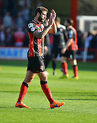 AFC Bournemouth's Steve Cook thanks supporters at the end of the Sky Bet Championship match between Bournemouth and Birmingham City at the Goldsands Stadium, Bournemouth, England on 6 April 2015. Photo by Mark Davies.