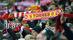 LIVERPOOL, ENGLAND - Sunday, December 13, 2009: Liverpool's supporters hold up a Fernando Torres scarf during the Premiership match at Anfield. (Photo by: David Rawcliffe/Propaganda)