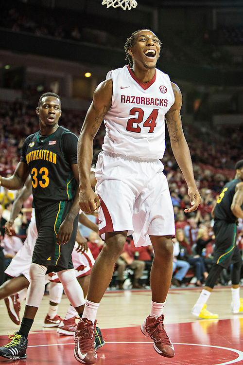 FAYETTEVILLE, AR - DECEMBER 3: Michael Qualls #24 of the Arkansas Razorbacks celebrates after dunking the ball against the SE Louisiana Lions at Bud Walton Arena on December 3, 2013 in Fayetteville, Arkansas.  The Razorbacks defeated the Lions 111-65.  (Photo by Wesley Hitt/Getty Images) *** Local Caption *** Michael Qualls