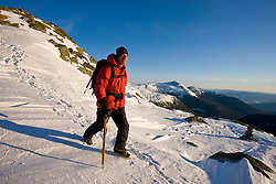 Climbing guide Paul Cormier on Mount Clay above the Great Gulf in New Hampshire's White Mountains.  Winter. Northern Presidential mountain range.  Gulfside Trail.