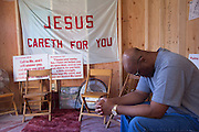 Donald Justice, a former drug addict, prays inside the &ldquo;Open Door,&rdquo; a makeshift prayer room located on the distressed lower south side.<br />