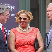 Delaware Governor John Carney, Mayor Mike Purzycki and City Council President Hanifa Shabazz, D.H.L. (CENTER) have a laugh during the changing of the guard as live nation takes over The Queen Theater Wednesday, June 14, 2017 on Market Street in downtown Wilmington Delaware.