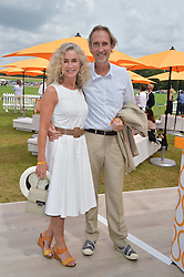 MIKE & ANGIE RUTHERFORD at the Veuve Clicquot Gold Cup Final at Cowdray Park Polo Club, Midhurst, West Sussex on 20th July 2014.