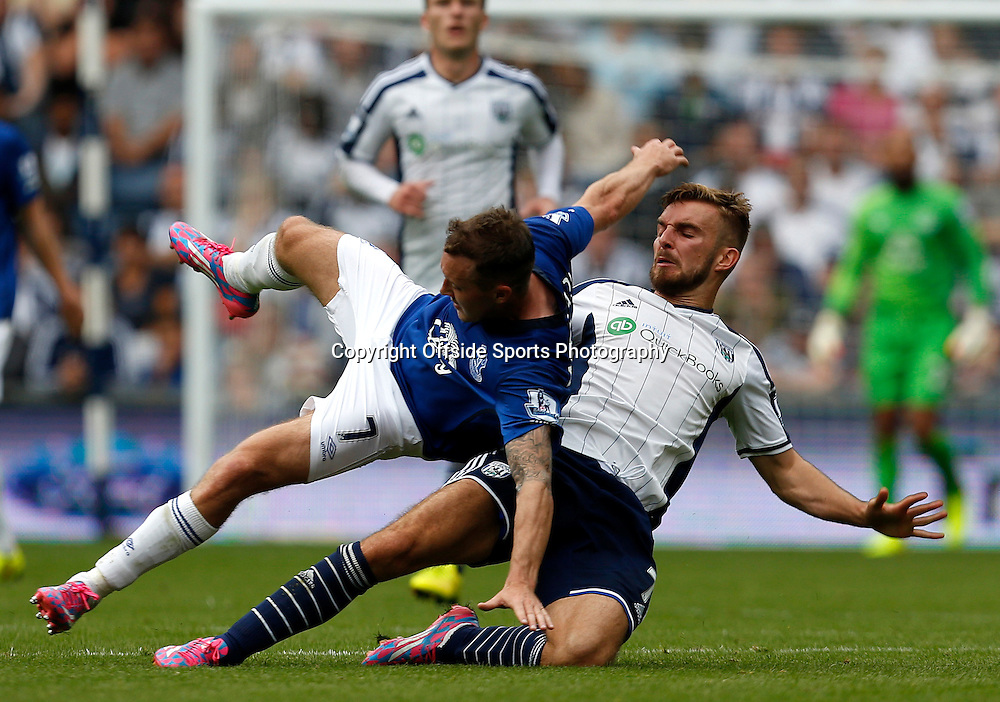 13th September 2014 - Barclays Premier League - West Bromwich Albion v Everton - Aiden McGready of Everton is fouled by James Morrison of West Bromwich Albion  - Photo: Paul Roberts / Offside.