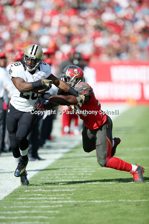 New Orleans Saints running back C.J. Spiller (28) gets shoved out of bounds by Tampa Bay Buccaneers outside linebacker Lavonte David (54) while running down the sideline during the 2015 week 14 regular season NFL football game against the Tampa Bay Buccaneers on Sunday, Dec. 13, 2015 in Tampa, Fla. The Saints won the game 24-17. (©Paul Anthony Spinelli)
