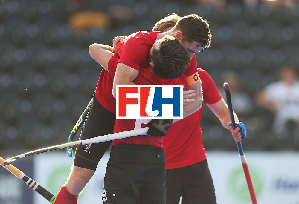 LONDON, ENGLAND - JUNE 16:  Iain Smythe of Canada (23) is congratulated as he scores their third goal during the Hero Hockey World League Semi-Final Pool B match between Pakistan and Canada at Lee Valley Hockey and Tennis Centre on June 16, 2017 in London, England.  (Photo by Alex Morton/Getty Images)
