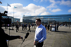© London News Pictures. 11/10/2016. Milton Keynes, UK. Dr Graeme Smith, CEO and chairman of Oxbotica being interviewed while driverless cars are tested around pedestrian areas in Milton Keynes in the first public test of autonomous electric vehicles in the UK. The vehicles have been developed by the Oxford Robotics Institute and Oxbotica. Photo credit: Ben Cawthra/LNP