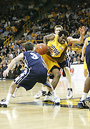 24 JANUARY 2007: Iowa forward Tyler Smith (34) drives in between Penn State guard Ben Luber (3) and guard Danny Morrissey (33) in Iowa's 79-63 win over Penn State at Carver-Hawkeye Arena in Iowa City, Iowa on January 24, 2007.
