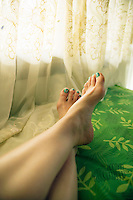 Female legs and feet in relaxed pose&#xA;<br />