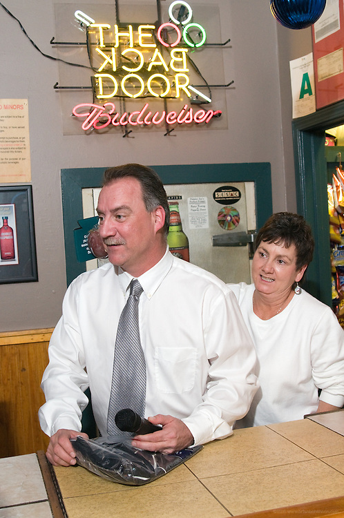 Owner John Dant prepares to draw another prize ticket to give away a tee shirt with his Irish twin Susan Mett at the 25th anniversary party for the The Back Door and The Back Burner Grill, Thursday, Jan. 14, 2010 in Louisville, Ky. (Photo by Brian Bohannon) Irish twins are born on the same day, but a year apart. She's the older...