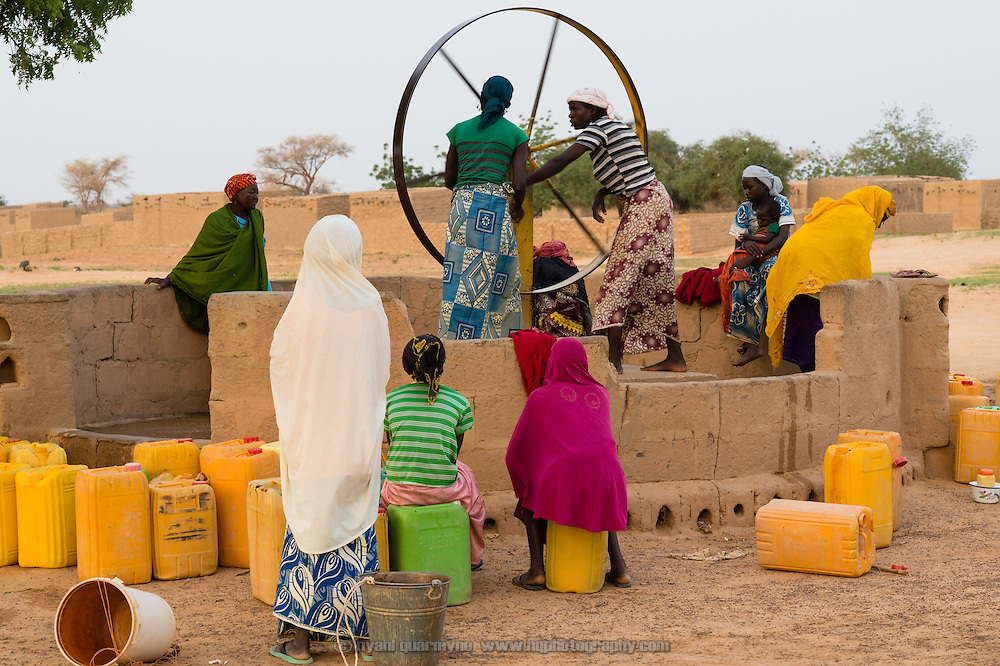 Women drawing water at a well refurbished by WaterAid in the village of Gadirga in the Commune of Soukoukoutan in the Dosso Region of Niger on 23 July 2013.