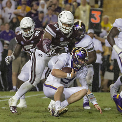 Oct 20, 2018; Baton Rouge, LA, USA; LSU Tigers quarterback Joe Burrow (9) is pursued by Mississippi State Bulldogs defensive tackle Jeffery Simmons (94) during the second quarter at Tiger Stadium. Mandatory Credit: Derick E. Hingle-USA TODAY Sports