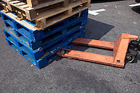 Forklift and wooden crates outdoors