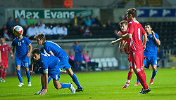 SWANSEA, ENGLAND - Friday, September 4, 2009: Wales' Aaron Ramsey (hidden) scores the second goal against Italy during the UEFA Under 21 Championship Qualifying Group 3 match at the Liberty Stadium. (Photo by David Rawcliffe/Propaganda)