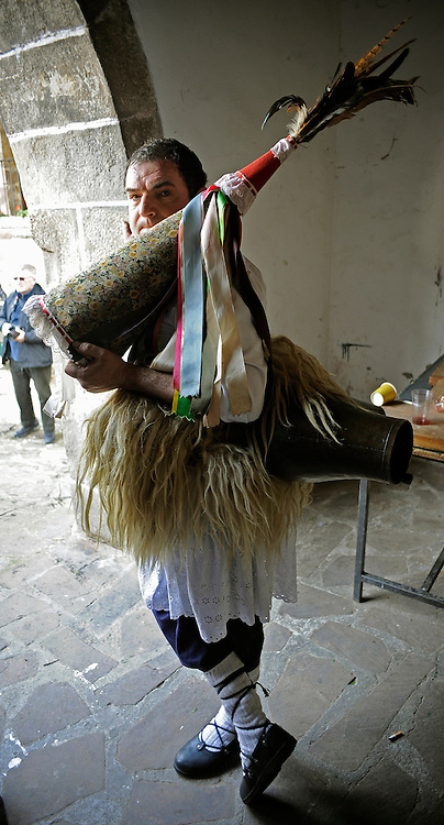 "A ""Joalduna"" (""that who plays the bell"") gets ready to carry big cowbells tied to his back during the ancient carnival of Zubieta, in the northern Spanish province of Navarra province, on January 29, 2013."