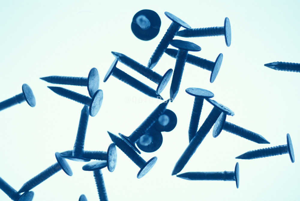 silhouette of pile of small nails