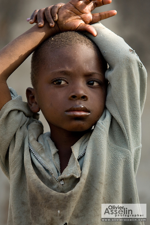 Portrait of a boy with dirty, worn t-shirt. Northern Ghana, Thursday November 13, 2008.
