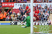 Brentford Defender Jake Bidwell shoots during the Sky Bet Championship match between Brentford and Sheffield Wednesday at Griffin Park, London, England on 26 September 2015. Photo by Phil Duncan.