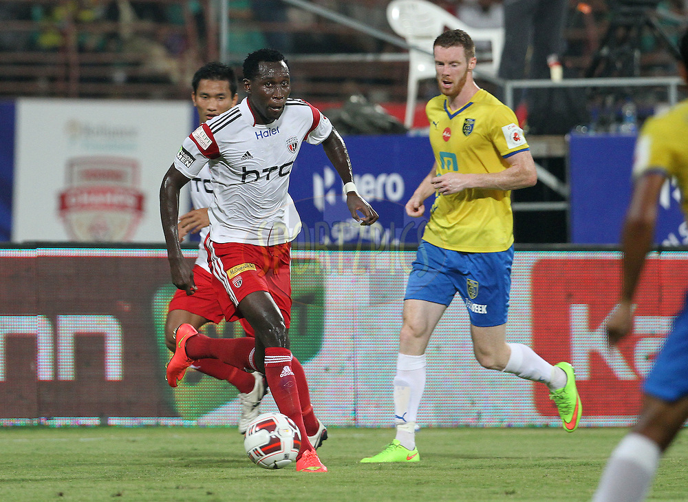 Kondwani Mtonga of NorthEast United FC on the attack during match 49 of the Hero Indian Super League between Kerala Blasters FC and North East United FC held at the Jawaharlal Nehru Stadium, Kochi, India on the 4th December 2014.<br /> <br /> Photo by:  Vipin Pawar/ ISL/ SPORTZPICS