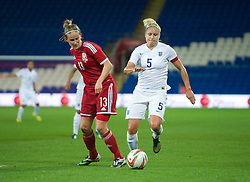 CARDIFF, WALES - Tuesday, August 21, 2014: Wales' Carys Hawkins and England's captain Steph Houghton during the FIFA Women's World Cup Canada 2015 Qualifying Group 6 match at the Cardiff City Stadium. (Pic by Ian Cook/Propaganda)