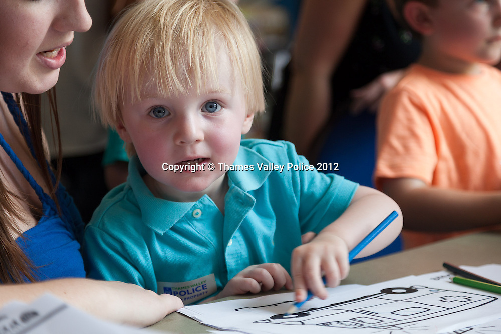 Alfie Bateman, helped by mum Claire, enjoys some of the colouring sheets available at the Family Events Police Day held at Oxford Brookes University by Thames Valley Police. Oxford, UNITED KINGDOM. August 18 2012. <br /> Photo Credit: MDOC/Thames Valley Police<br /> &copy; Thames Valley Police 2012. All Rights Reserved. See instructions.