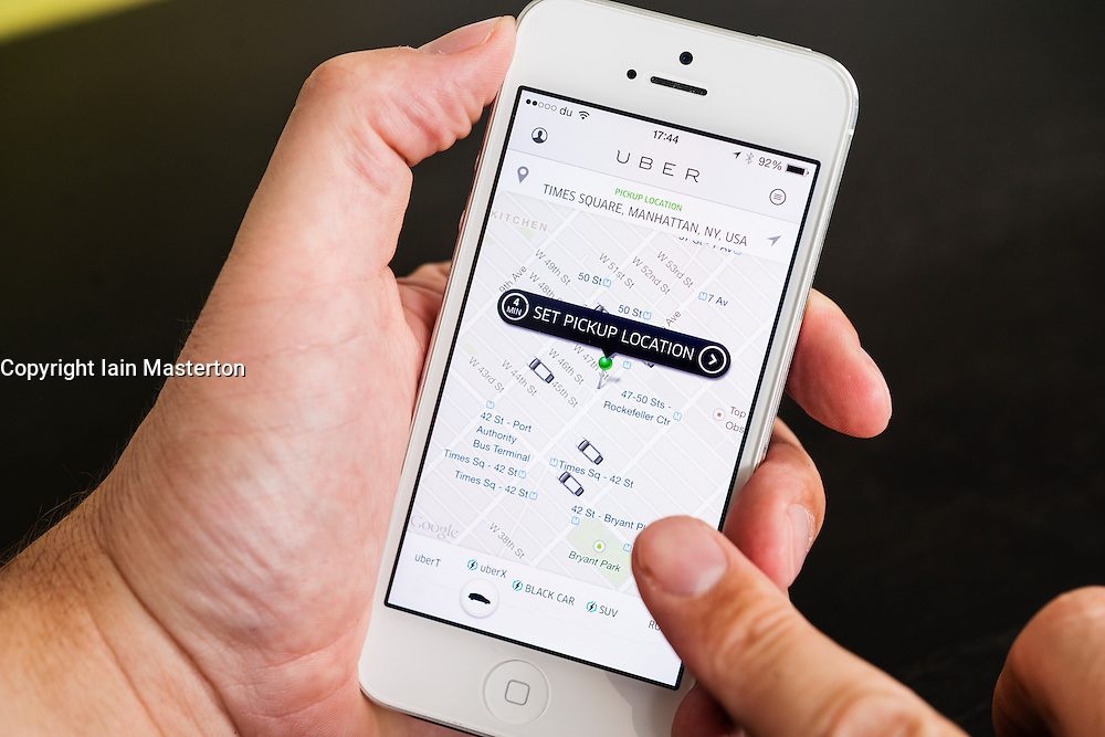 Detail of Uber taxi booking  app showing pickup locations in New York City  on iPhone  smart phone