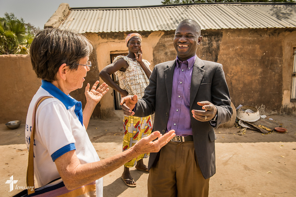 The Rev. Remi Lare Lambon, pastor in the Lutheran Church of Togo and Valerie Stonebreaker, LCMS missionary to Togo, share a moment on Tuesday, Feb. 14, 2017, at a rural village home in Sankpong, Togo. LCMS Communications/Erik M. Lunsford