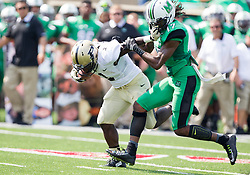 Sep 6, 2015; Huntington, WV, USA; Purdue Boilermakers running back D.J. Knox is tackled by Marshall Thundering Herd safety Taj Letman during the first quarter at Joan C. Edwards Stadium.  Mandatory Credit: Ben Queen-USA TODAY Sports