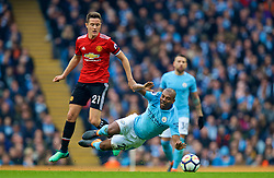 MANCHESTER, ENGLAND - Saturday, April 7, 2018: Manchester City's Fernando Luiz Roza 'Fernandinho' and Manchester United's Ander Herrera during the FA Premier League match between Manchester City FC and Manchester United FC at the City of Manchester Stadium. (Pic by David Rawcliffe/Propaganda)