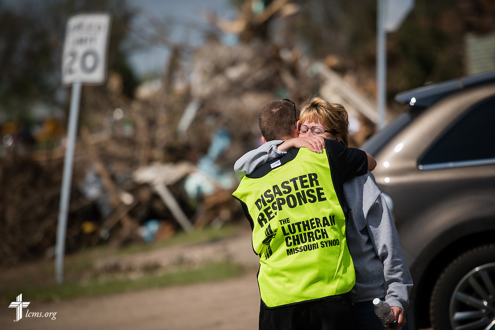 The Rev. Brian Bucklew, pastor at Zion Lutheran Church, hugs Sonia Will on Tuesday, May 12, 2015, in Delmont, S.D. A tornado swept through the area on Sunday and destroyed the church where Bucklew is pastor along with surrounding buildings in the neighborhood. LCMS Communications/Erik M. Lunsford
