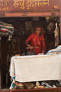 Women working an 'ironing lady'. Jaisalmer. Rajasthan, INDIA<br /> Heavy ankle bracelets are common as well as nose rings and silver bangles.<br /> Founded in 1156 Jaisalmer grew to be a major staging post on the trade route across the forbidding Thar desert from India to the west. It is known as the Golden City as the fort and town's buildings are built from the local yellow sandstone. The bustling narrow streets are lined with tradesmen selling their wares. Many of the smalll shops are occupied by descendents of the original owners. There are many exceptional Havelis (mansions of rich merchants - exquistely carved) both in the fort and the old walled town.