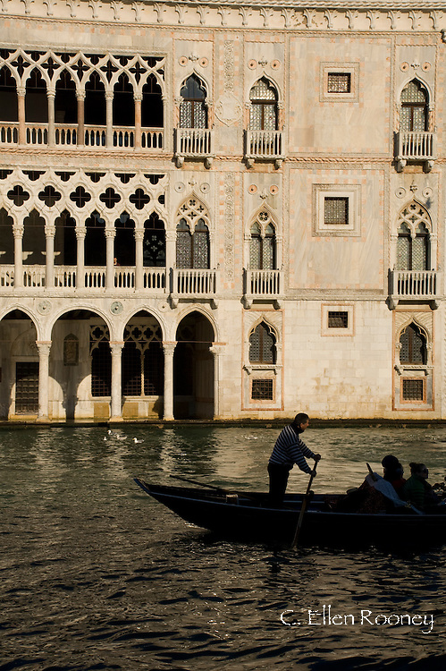 A gondola on The Grand Canal in front of the Palazzo Ca D'Oro on The Grand Canal;  Venice, Italy