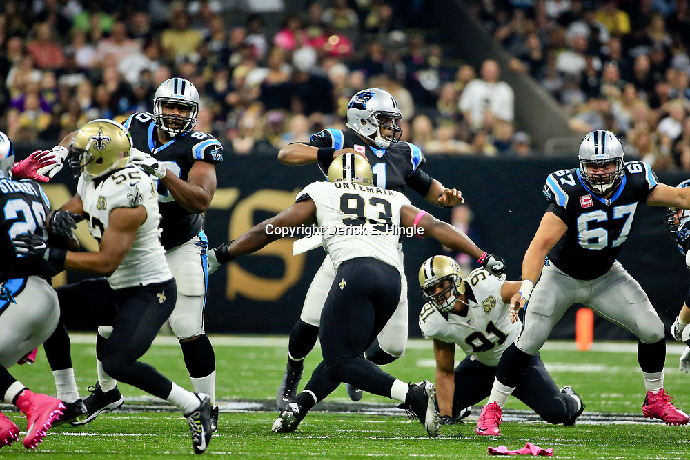 Oct 16, 2016; New Orleans, LA, USA; Carolina Panthers quarterback Cam Newton (1) is sacked by New Orleans Saints defensive end Kasim Edebali (91) and defensive tackle David Onyemata (93) during the first quarter of a game at the Mercedes-Benz Superdome. Mandatory Credit: Derick E. Hingle-USA TODAY Sports